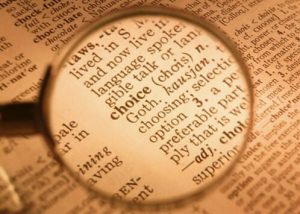 Choice word in a dictionary under magnifier
